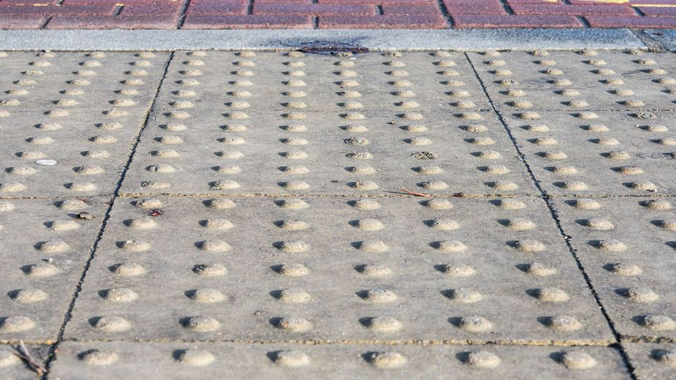 Bubble paving, which provides information to pedestrians through texture alone  can be found at crossings in towns and cities throughout Britain (Credit: Amanda Ruggeri)