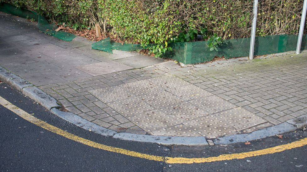 A square or rectangular swath of dimpled paving denotes that the kerb is dropping into a road crossing (Credit: Amanda Ruggeri)