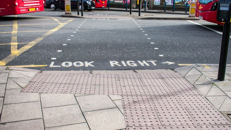 An L-shaped section of dimpled paving shows that this is a pedestrian crossing with lights (Credit: Amanda Ruggeri)