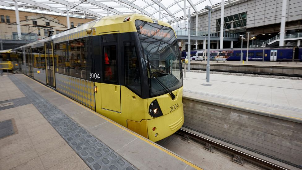The edge of the platform for the Manchester Metrolink, a light rail system, is marked with lozenge-shaped blisters (Credit: Alamy)