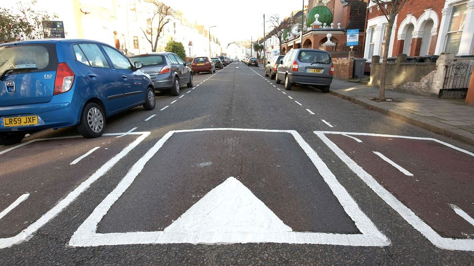 In London, transport officials have been painting optical illusions of physical speed humps onto the roads (Credit: Alamy)