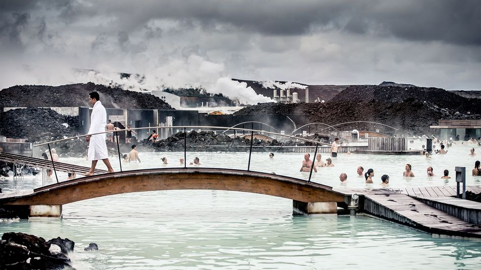 The Blue Lagoon has long been one if Iceland's most popular attractions. The artificial pool is warmed by a nearby geothermal power plant (Credit: Getty Images)
