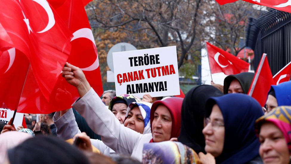 Turkish people scoring higher in collective narcissism were more likely to hold hostile views towards Germans - as seen in this protest (Credit: Getty Images)