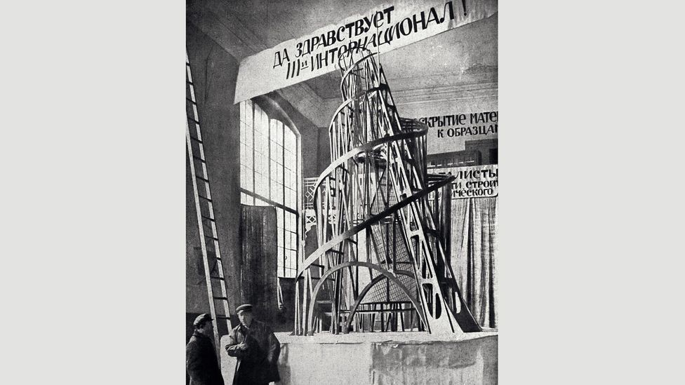 Tatlin and an assistant stand before a model of his unrealised Monument to the Third International (Credit: Alamy)