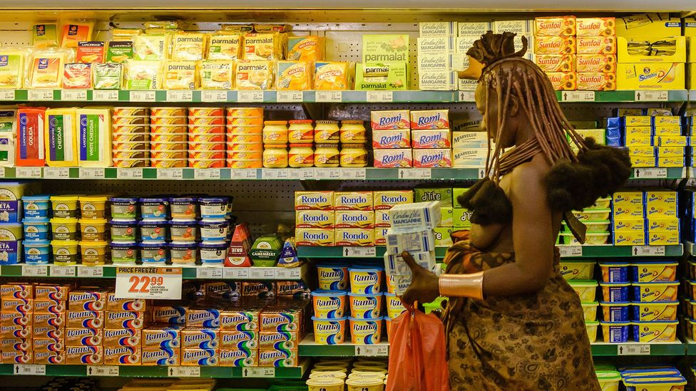 A Himba woman goes grocery shopping in Opuwo. Exposure to this busy visual environment may permanently change her perception (Credit: Alamy)
