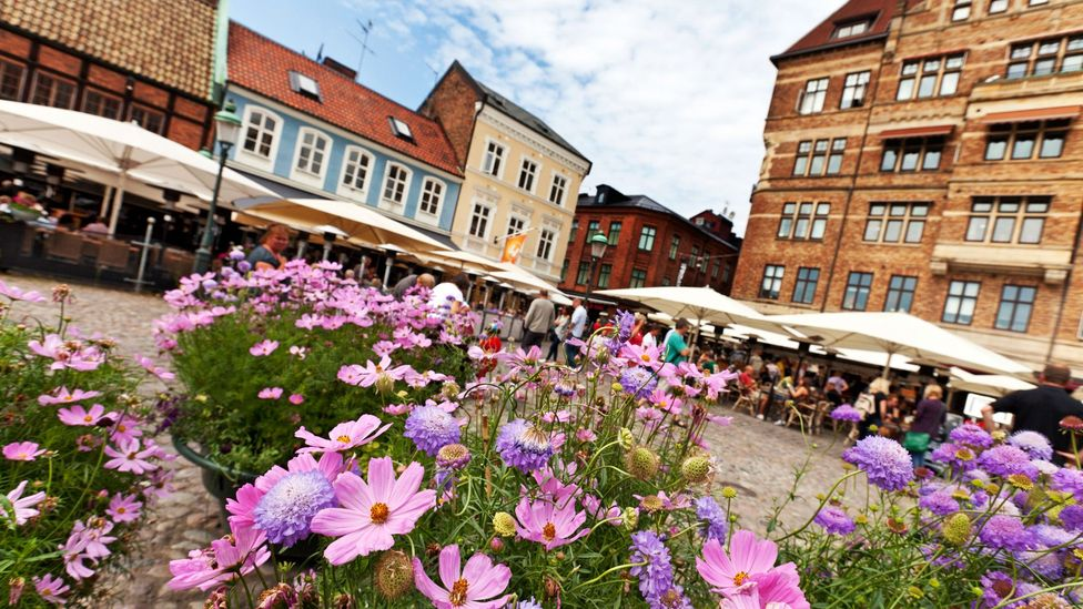Lilla Torg Square, where people in Malmo walk and enjoy outdoor meals (Credit: Alamy)