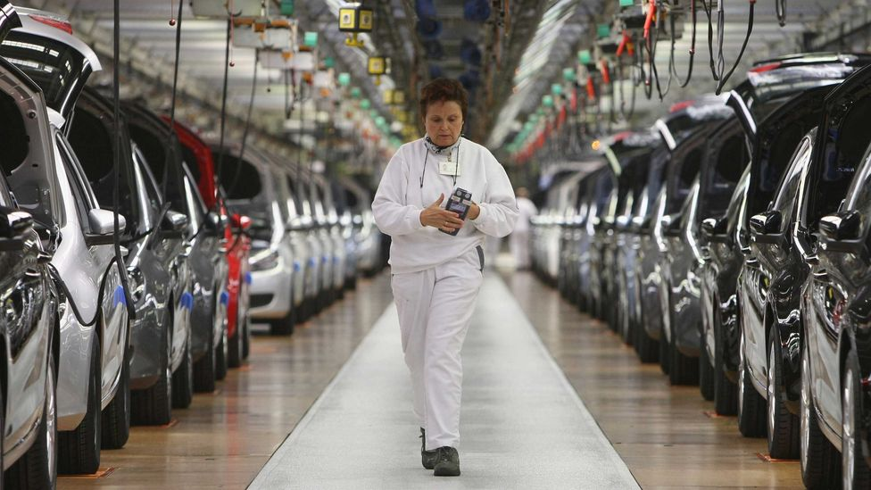 Finished cars on the assembly line at a Volkswagen car factory in Germany (Credit: Getty Images)