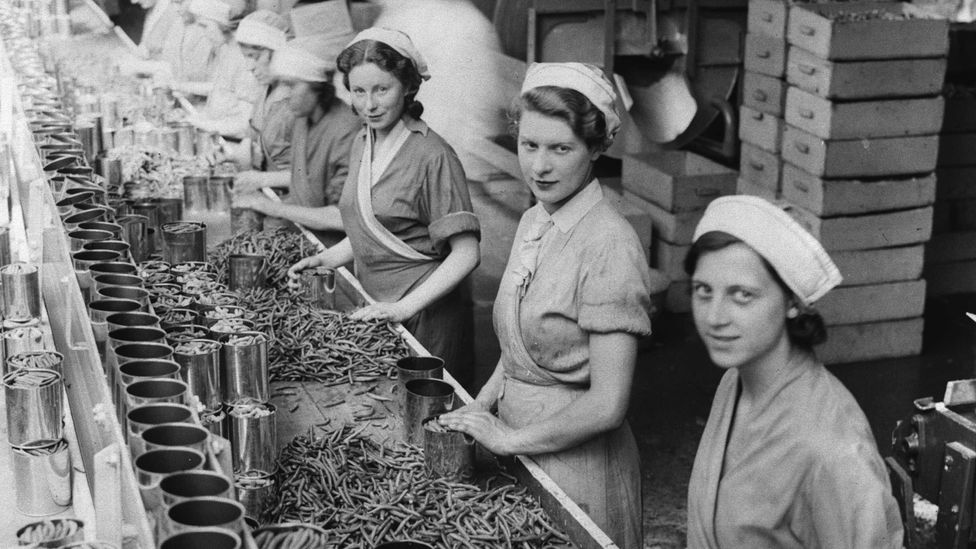 In 1934, women on a production line canning beans in Cambridgeshire, UK - a job that no longer exists (Credit: Getty Images)