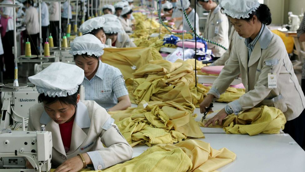 North Korean women work with dexterity at a South Korean textile company (Credit: Getty Images)