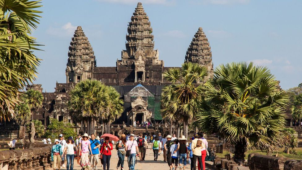 Angkor Wat is the largest religious complex in the world, covering a space of 500 acres (2 sq km) – it was initially  built as a Hindu temple to honour Vishnu (Credit: Alamy)