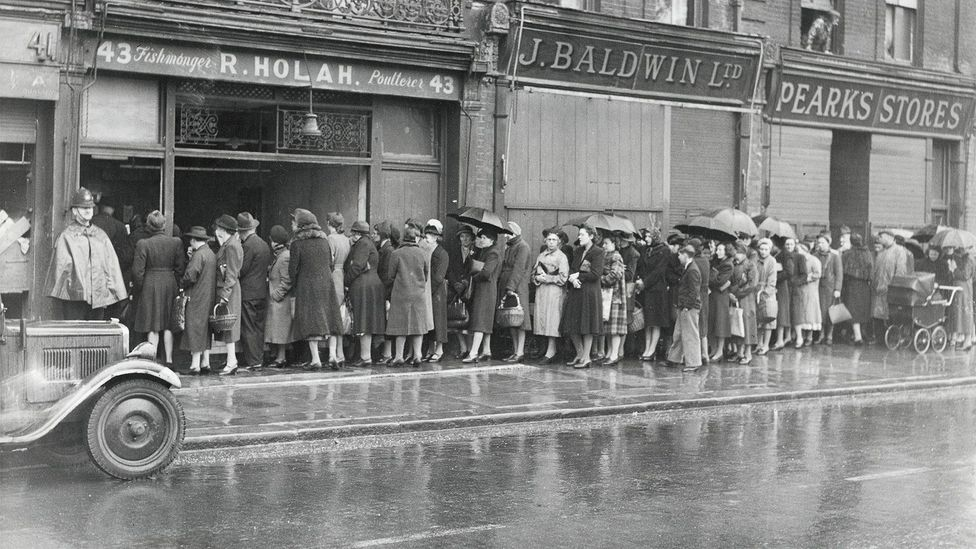 Some commentators claim that British pride in queuing came after World War Two, as the public waited patiently for their rations (Credit: Getty Images)