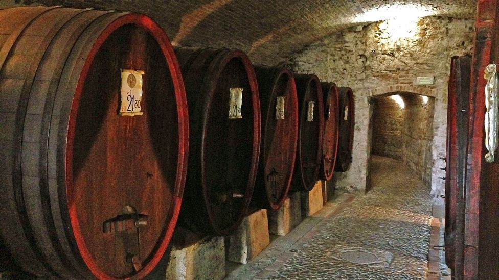 The passageway between the inn and Machiavelli's home is lined with ceiling-high barrels (Credit: Silvia Marchetti)
