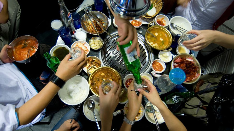 A group of friends gathers for a barbecue at a restaurant in Seoul (Credit: Alamy)