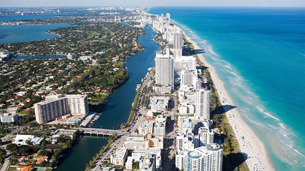 Like other popular areas including Sunny Isles and Hollywood Beach, Miami Beach is a narrow barrier island with the ocean on one side (Credit: Alamy)