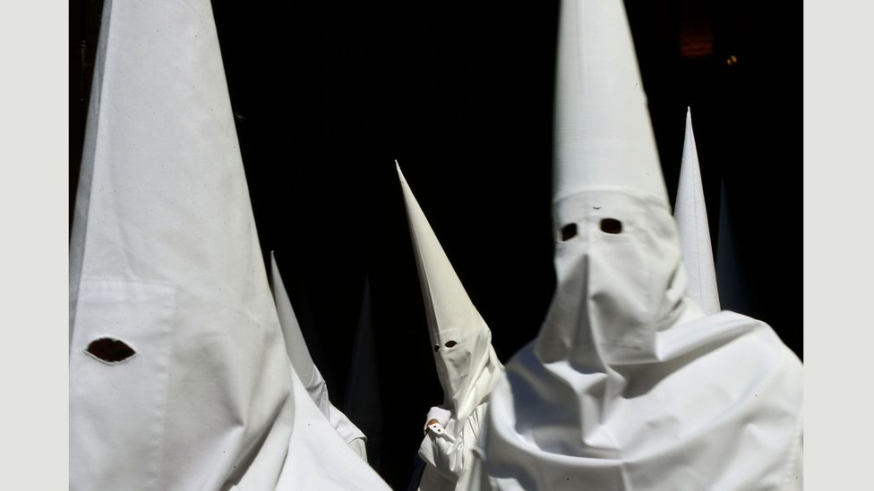 La Borriquita brotherhood hide their identities with pointy hooded hats in a ritual that dates back as far as the Inquisition (Credit: Getty Images)