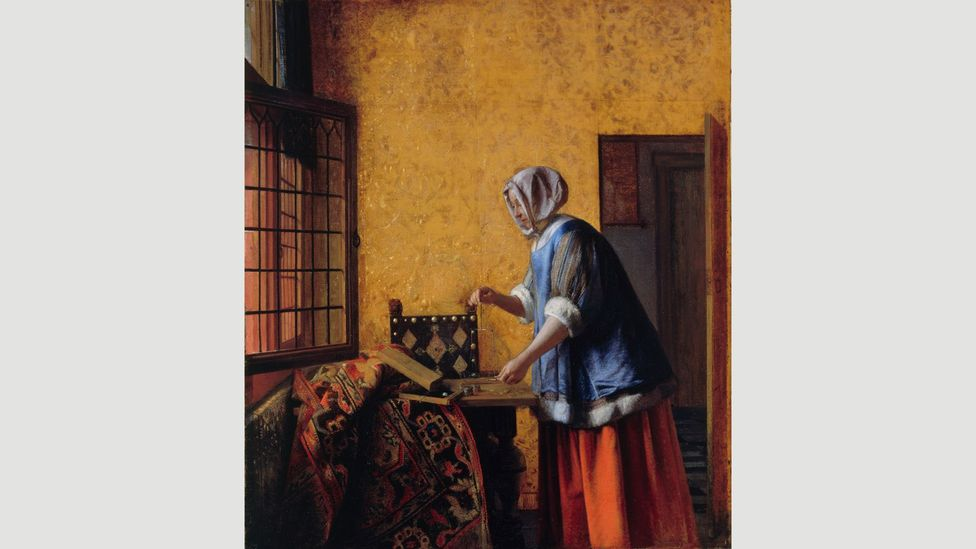 The rich clothes of the subject in Pieter de Hooch's Woman Weighing Gold Coin suggest she is the wealthy wife of a money lender (Credit: BPK, Berlin)