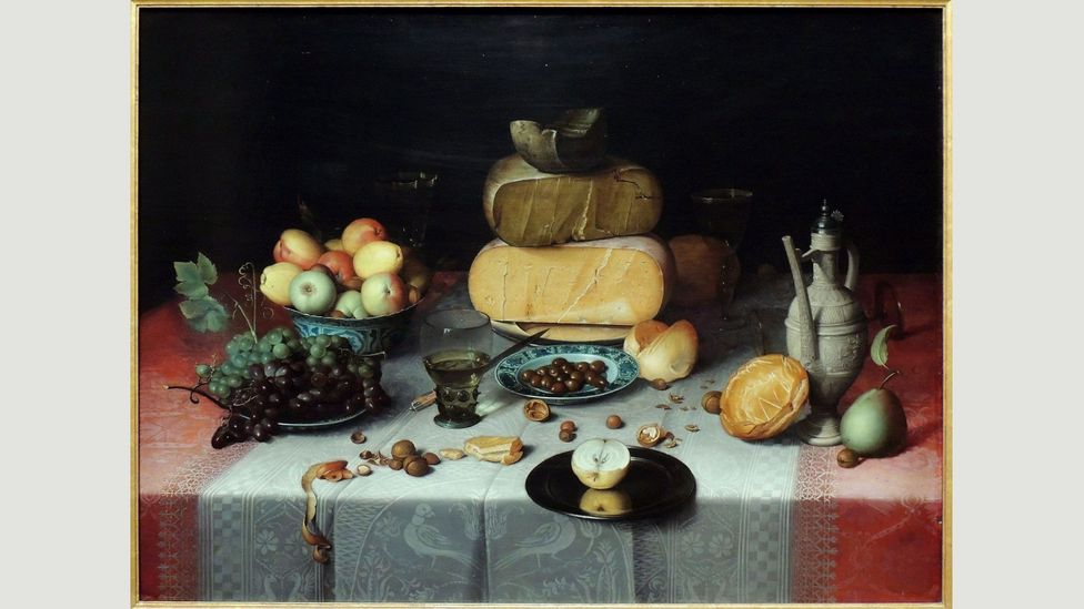 Floris van Dijck's stack of cheese is rendered with the gravitas of rock, placed on a table covered in a rich red damask cloth (Credit: Alamy)