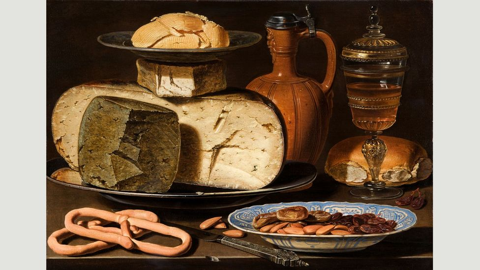 Clara Peeters' Still Life with Cheeses, Almonds and Pretzels presents a halved Gouda in fine detail as a knife points enticingly outwards (Credit: Alamy)