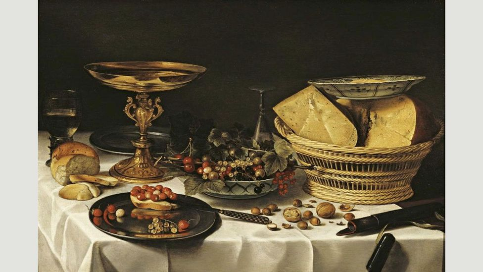 A dish of butter curls rests precariously on Pieter Claesz's basket of cheeses (Credit: Alamy)