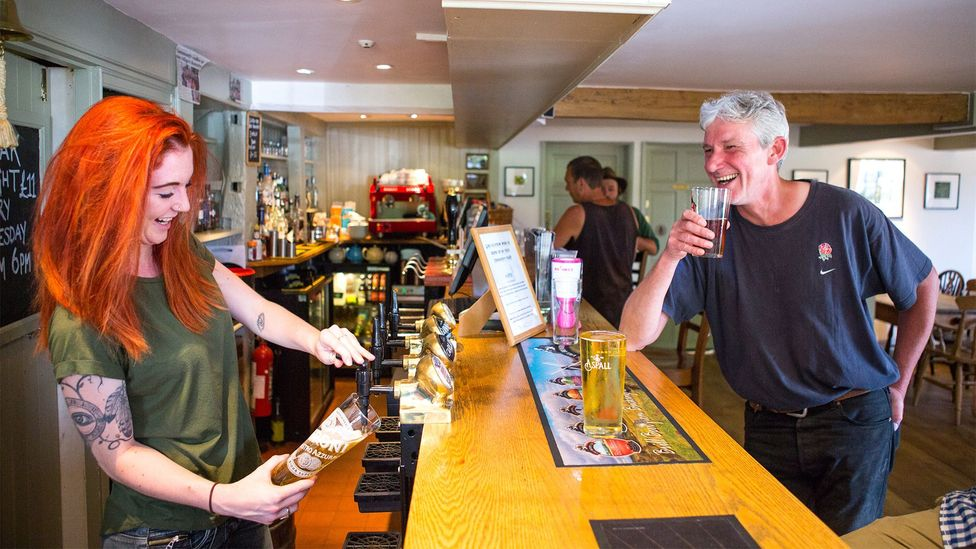 A local is served at the 400-year-old Seven Stars pub near Oxford; it closed in 2012 and was reopened by the community in 2013 (Credit: Plunkett Foundation)
