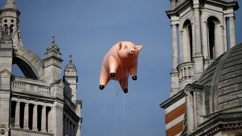 An inflatable pink pig recently flew over the V&A to announce the museum's Pink Floyd exhibition (Credit: Alamy)