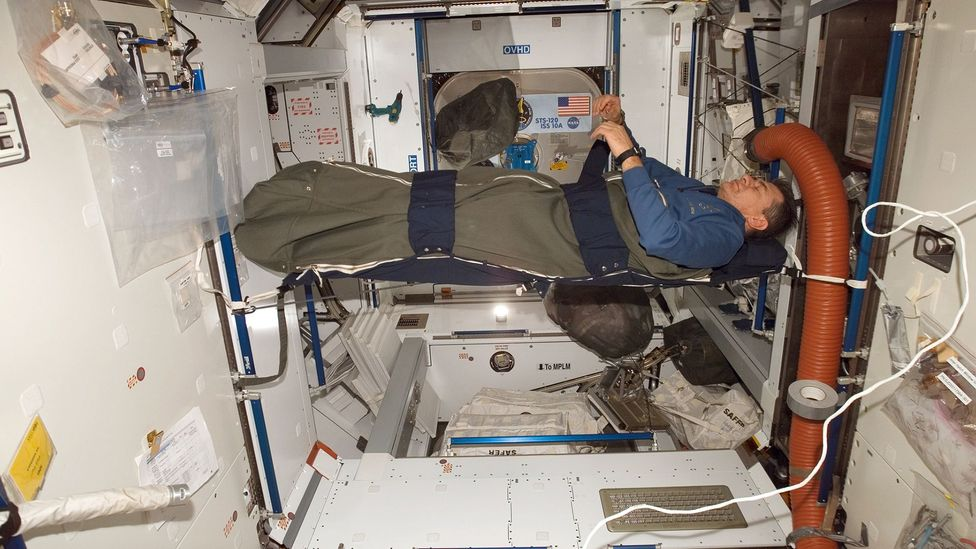 On the ISS, astronauts have to sleep tied to the wall - and they don't have any pillows (Credit: Nasa)