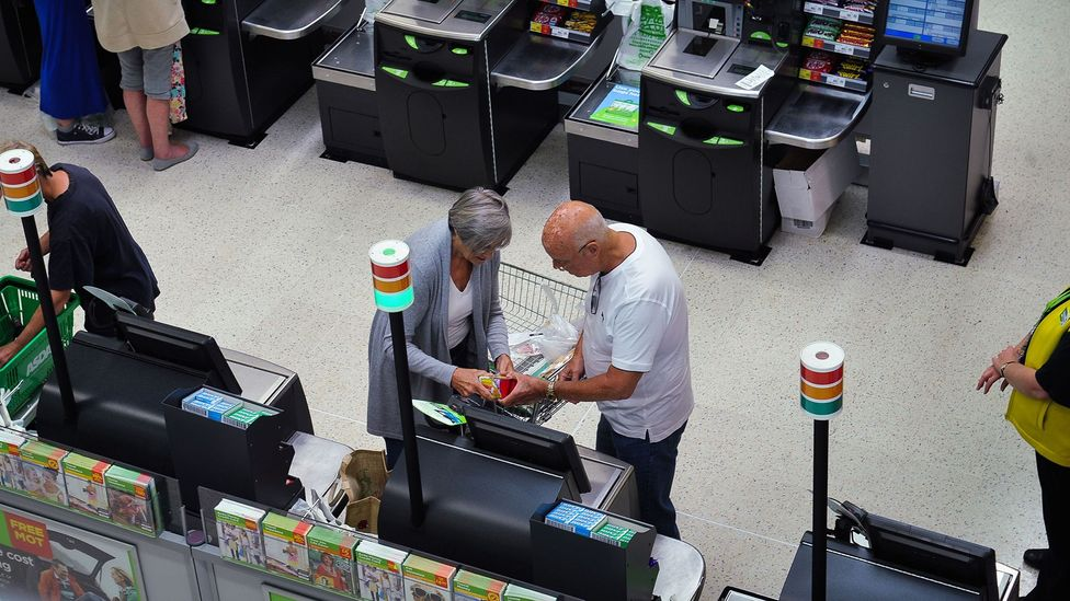 Self checkouts have been criticised for being confusing for some customers, and poorly designed: the change slot often demands bending over (Credit: Alamy Stock Photo)