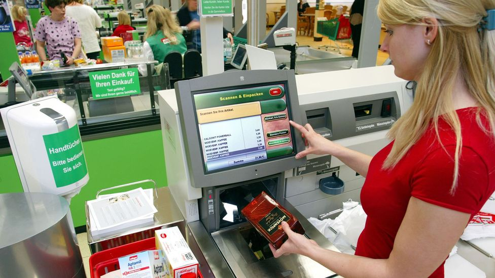 Some shoppers find self-checkouts irritating, whilst others think they're more convenient than interacting with another human at the till (Credit: Alamy Stock Photo)