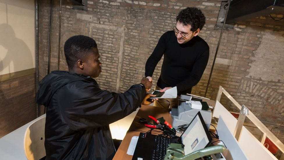 In Venice, NSK 'citizens' work to issue passports to new applicants, such as the author of this article (Credit: Davide Carpenedo)