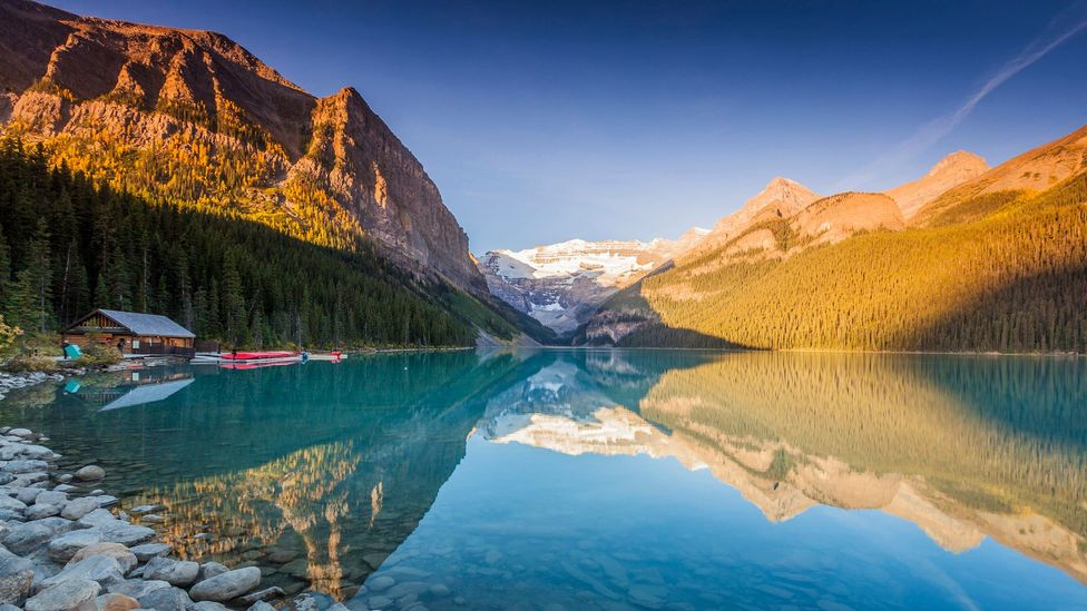 The clean mountain air from Lake Louise in the Canadian Rocky Mountains can seem attractive to those living in polluted cities (Credit: Getty Images)