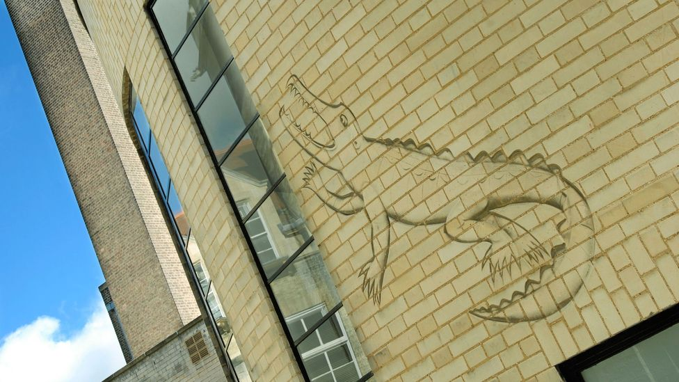 Part of the Arts and Crafts movement, Gill became quite experimental – such as carving this outline of a crocodile into the Mond Laboratory's wall at Cambridge (Credit: Alamy)