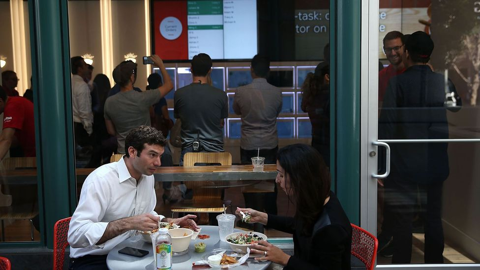 Customers dine outside Eatsa, San Francisco's first fully automated restaurant in 2015 - food is picked up in 'cubbies,' no server, wait staff or cashier required. (Credit: Getty)