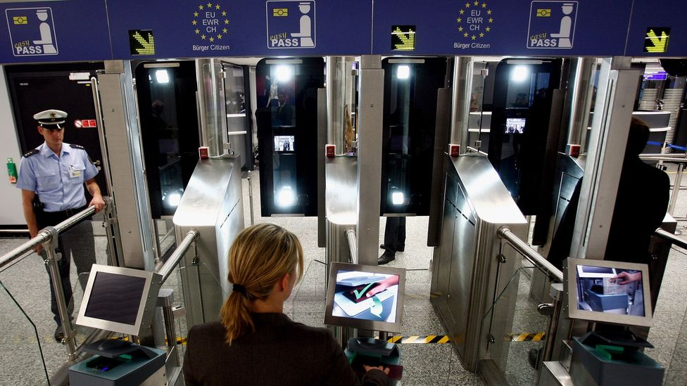 For the past several years, humans have worked more closely with self-service machines that assume certain employee duties, like passport scanning. (Credit: Getty Images)