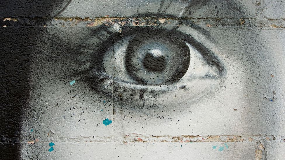 Some research has indicated that eyes painted on a wall can persuade people to moderate their behaviour, but this has not been confirmed by subsequent studies (Credit: iStock)