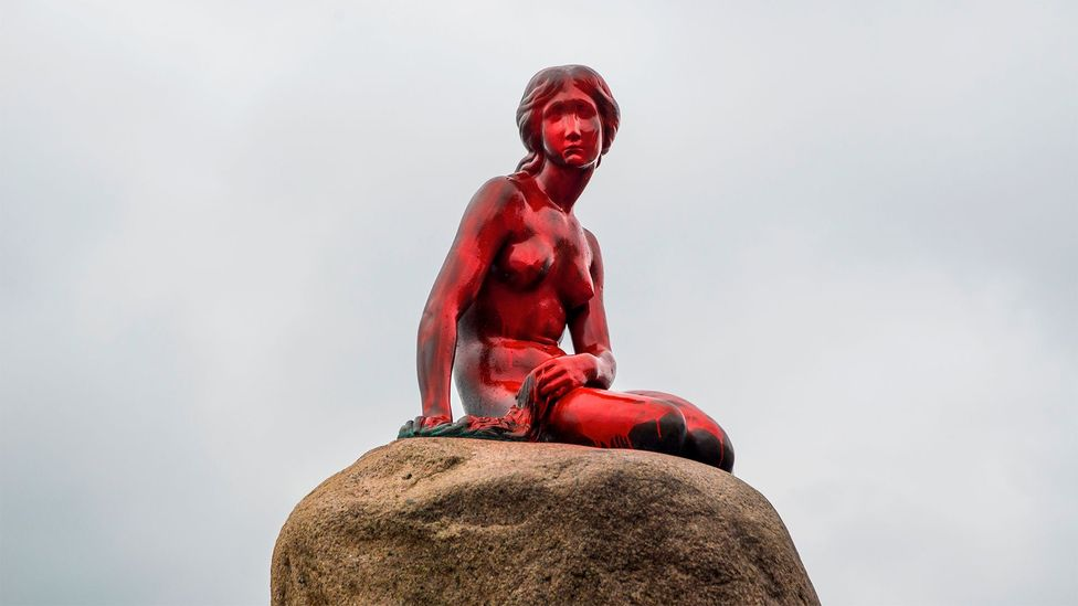 Anti-whaling activists splashed red paint on Edvard Eriksen's statue of The Little Mermaid (Credit: AP)
