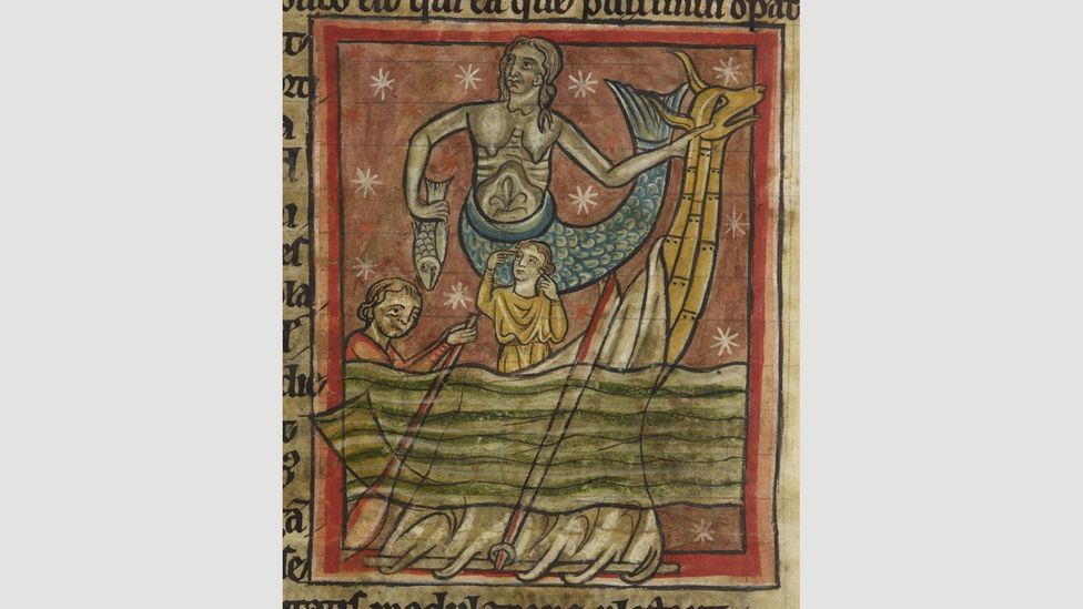 This 13th Century bestiary from England depicted a mermaid as a siren trying to lead sailors to their doom (Credit: Wikipedia)