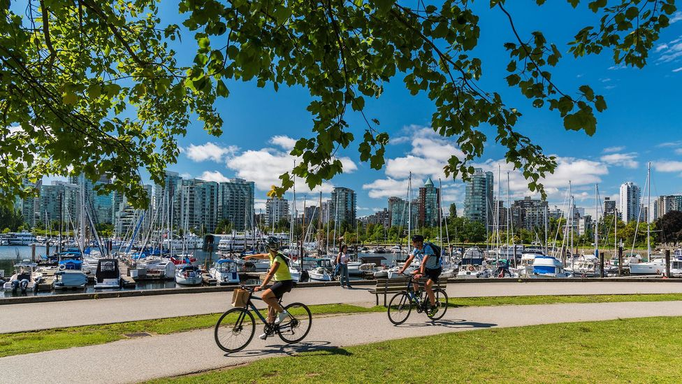 Cities like Vancouver, whose design and building policies accommodate nearby natural greenery, are often surveyed as popular places to live. (Credit: Alamy Stock Photo)