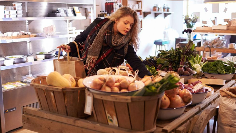 Woman shopping for groceries (Credit: Alamy)