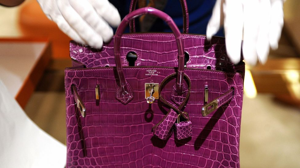 As more middle-class consumers own big TVs and fancy handbags, the rich are looking for different ways to show off their social position (Credit: Getty Images)