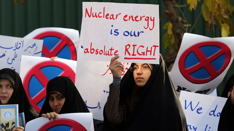 Not all nuclear rallies are anti. In Tehran, this student holds a sign backing Iran's nuclear programme (Credit: Getty Images)