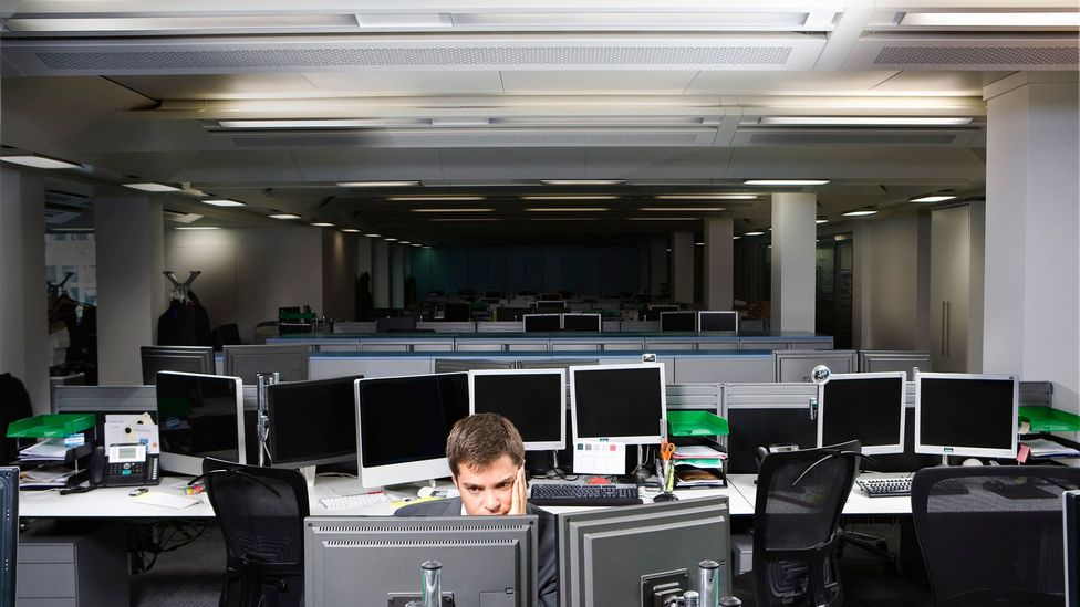 The fluorescent strip lighting often used in open plan offices can feel dingy and harsh (Credit: Getty Images)