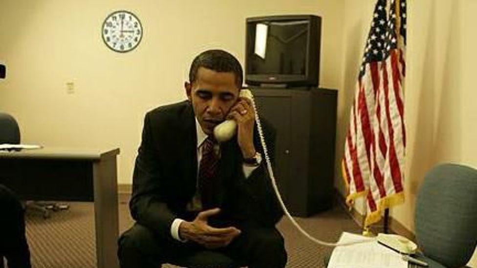 This photo of Barack Obama circulated in 2008, but is fake - the clock is a clue, a reference to a Hillary Clinton TV ad about picking up the phone at 3:00 (Credit: Snopes)