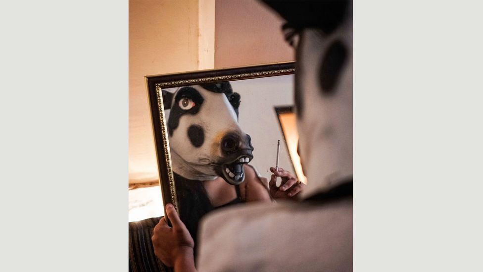 """Sujatro Ghosh has been photographing women wearing a cow mask as """"a silent form of protest"""" (Credit: Sujatro Ghosh)"""