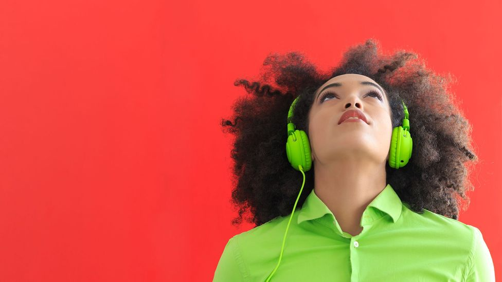 Woman wearing headphones (Credit: iStock)