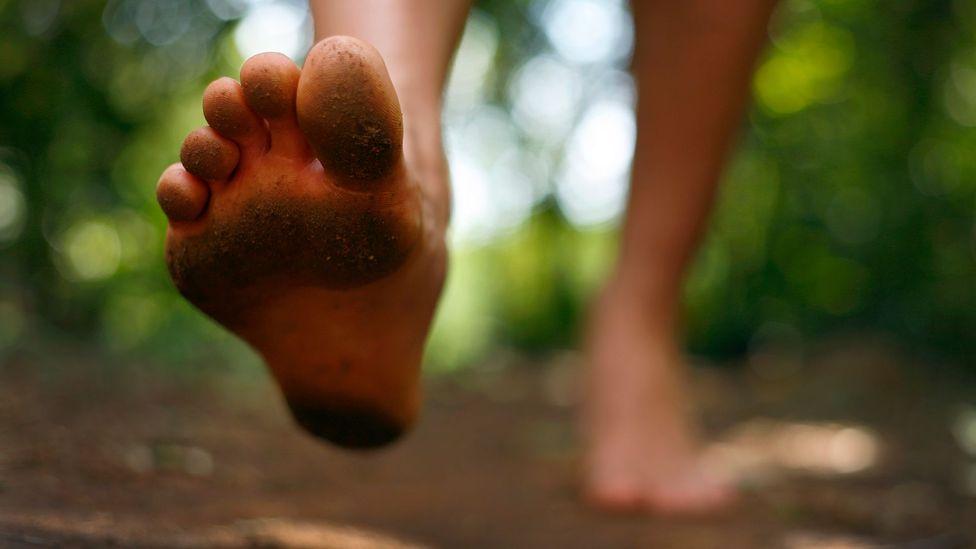 Person running barefoot (Credit: iStock)