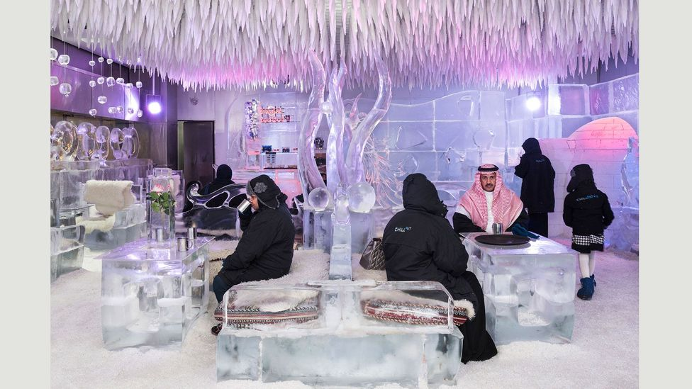 Saudi tourists having a hot chocolate at the Chillout Ice Lounge, the first subzero ice lounge in the Middle East, 6 January 2016 (Credit: Nick Hannes)