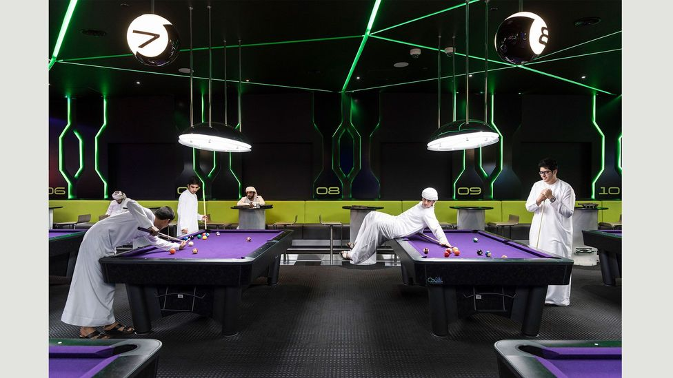 Emirati boys playing a game of pool at City Walk shopping mall's gaming and entertainment complex Hub Zero, 5 January 2017 (Credit: Nick Hannes)
