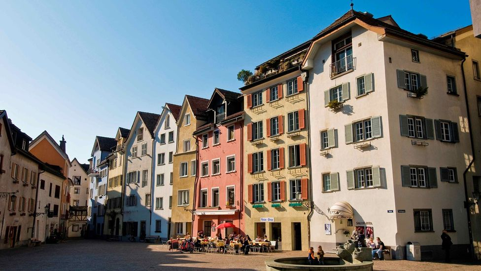 Switzerland's anti-war policy has preserved historical sites like those in Chur, the country's oldest city (Credit: Marka/Getty Images)