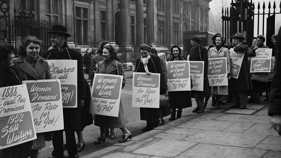 A protest by UK civil servants in the mid 20th Century. One sign reads: '1888 equal pay promised; 1952 still waiting' (Credit: Evening Standard/Getty Images)