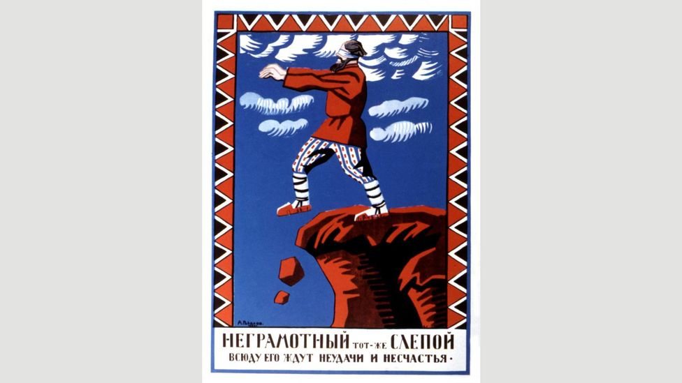 The Soviet government promoted the importance of literacy via posters like this one that suggested the inability to read is akin to a blind man walking off a cliff (Credit: Alamy)